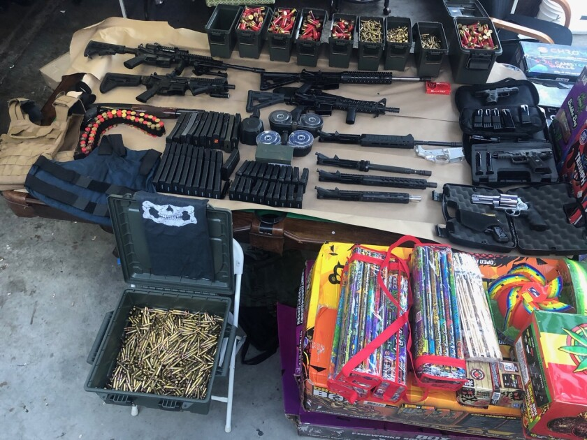 Santa Ana police found a cache of weapons and ammunition in a suspect's home.