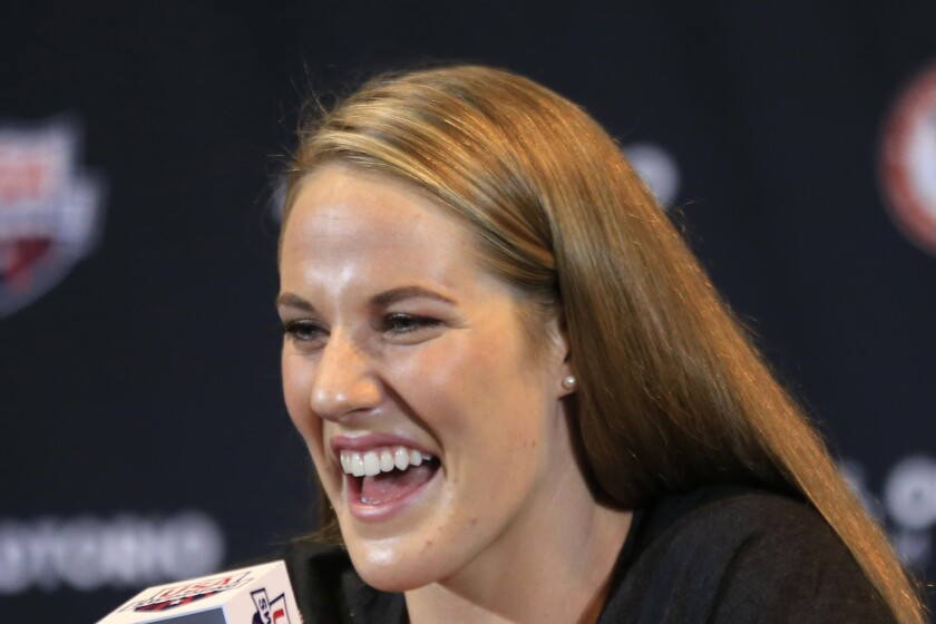 FILE - In this June 25, 2016, file photo, Olympic champion Missy Franklin answers a reporters question during a news conference at the U.S. Olympic team swimming trials in Omaha, Neb. Five-time Olympic champion Missy Franklin has married former Texas swimmer Hayes Johnson in suburban Denver. The 24-year-old Franklin announced Saturday's, Sept. 14, 2019, wedding via Instagram. (AP Photo/Orlin Wagner, File)