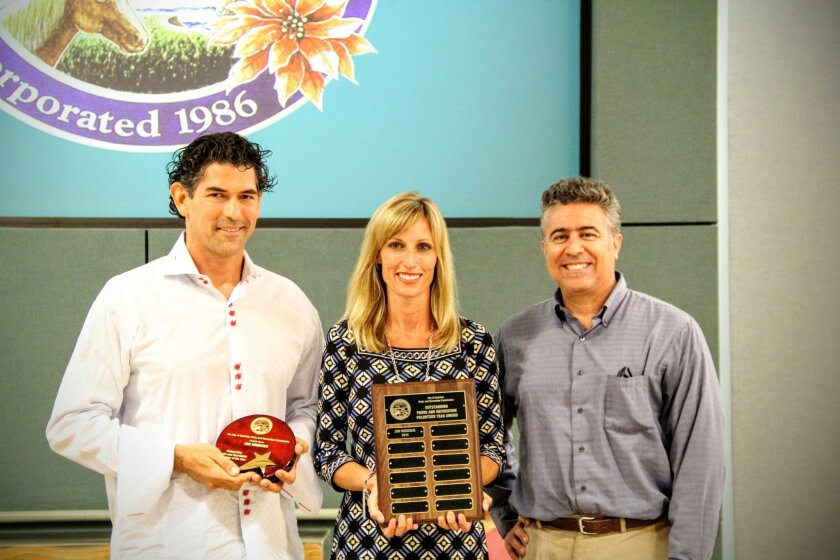 Jon Rodrigue, left, of Encinitas accepts his Parks and Recreation Volunteer of the Year award from Mayor Kristin Gaspar, middle, and Parks and Recreation Commission chair John Gjata at the June 8 city council meeting.