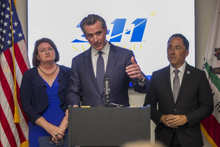 California Governor Gavin Newson, middle, Senator Toni Atkins, left, and Rep Todd Gloria, right visited visited 2-1-1 San Diego on Friday, August 9, 2019 to highlight progress that the state has made in getting affordable health care available to people without insurance.
