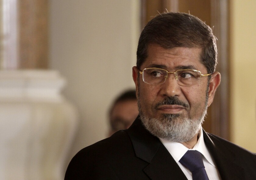 Mohamed Morsi, seen in 2012, maintains he is still Egypt's legitimate leader, a Turkish news report said.
