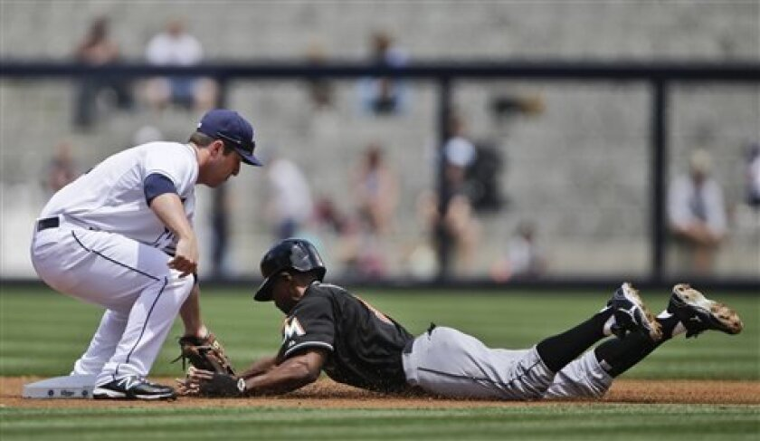 San Diego Padres second baseman Jedd Gyorko tags out Miami Marlins' Juan Pierre, who is out trying to steal second base, in the first inning of a baseball game in San Diego, Wednesday, May 8, 2013. (AP Photo/Lenny Ignelzi)