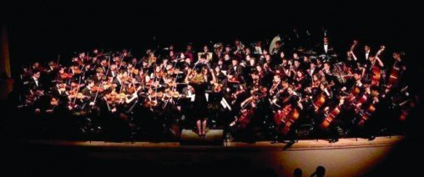 Torrey Pines High Music Director Amy Willcox conducts the full orchestra.