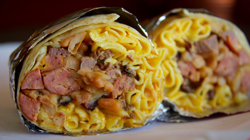 The two-pound Brisket Mac Link burrito, which comes loaded with diced chunks of Ray's signature brisket, mac and cheese, smoked jalapeño-cheddar links imported from Southside Market in Elgin, Texas, and house-made baked beans all tightly wrapped in a humongous flour tortilla.