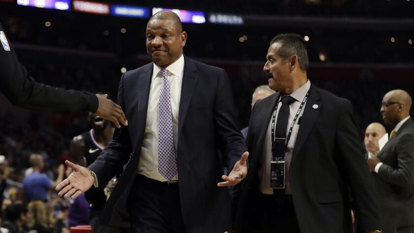 Clippers head coach Doc Rivers is escorted off the court after being ejected against the Chicago Bulls.