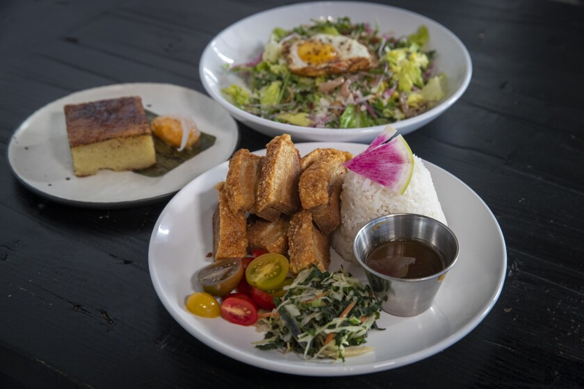 Maharlika salad, lechon kawali and bibingka brûlée at Bebot Filipino Soul Food in Long Beach.