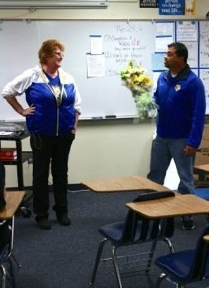 San Pasqual High Principal Tom McCoy greets district teacher of the year Paula Zimmerman on March 22 at the school.