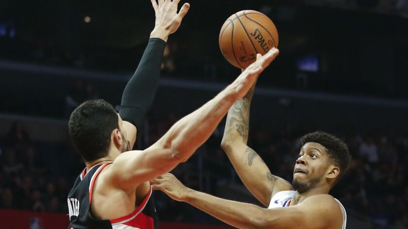 Clippers' Tyrone Wallace (9) shoots over Portland Trail Blazers' Enes Kanter (00) during a the game on Tuesday at Staples Center.