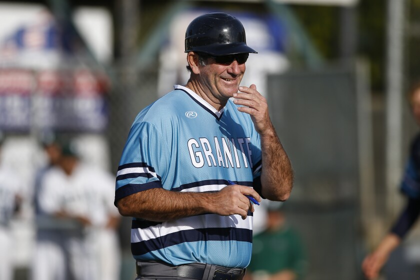 Granite Hills head coach James Davis reacts after being benched by the home plate umpire for arguing after a late hit by pitch call on a Helix batter.