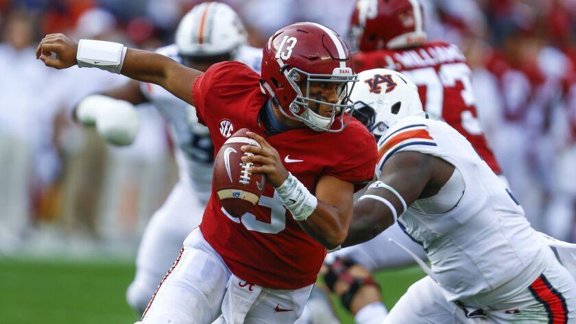 FILE - In this Saturday, Nov. 24, 2018, file photo, Alabama quarterback Tua Tagovailoa (13) escapes