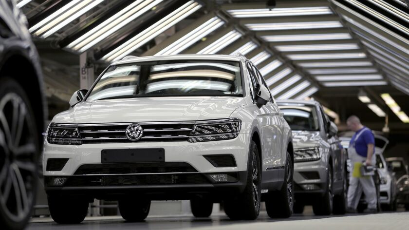 In this Thursday, March 8, 2018 photo Volkswagen cars are pictured during a final quality control at
