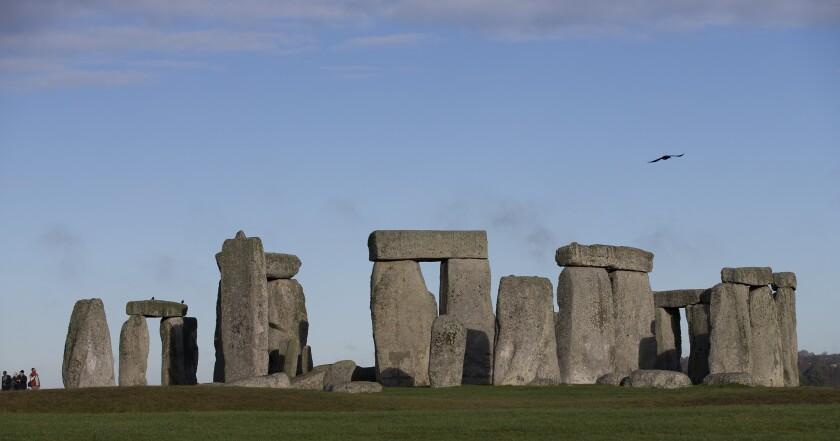 Visitors take photographs of Stonehenge, England.