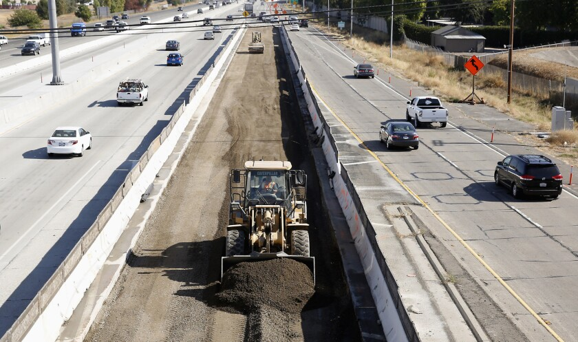 Vehicles pass a highway construction site on Interstate 80 in Sacramento on Oct. 15.
