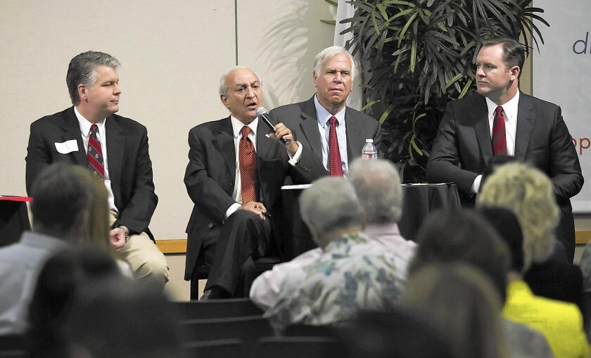 Newport Beach City Council candidate Fred Ameri, second from left, participates in a candidates forum this month. A resident's lawsuit claims Ameri should be listed on the November ballot by his given name, Farrokh Ameri.