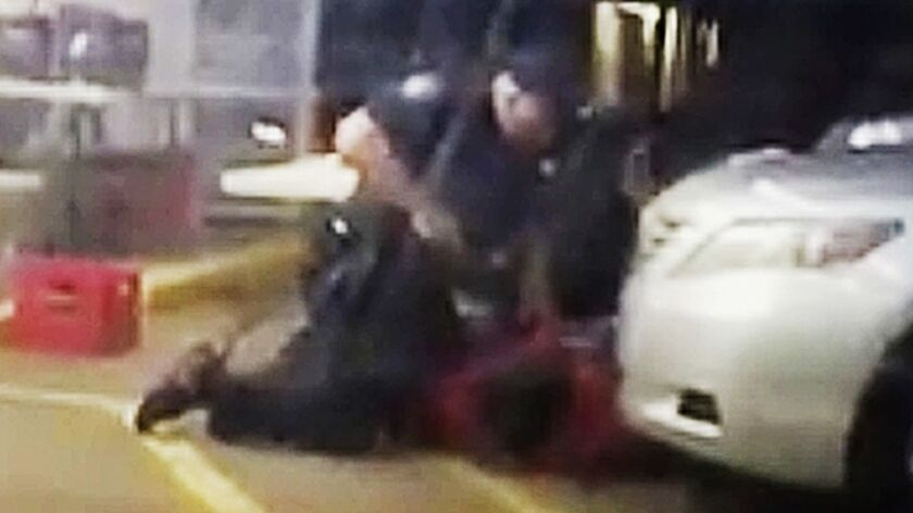 FILE - In this July 5, 2016 image made from video provided by Arthur Reed, Alton Sterling is restrai