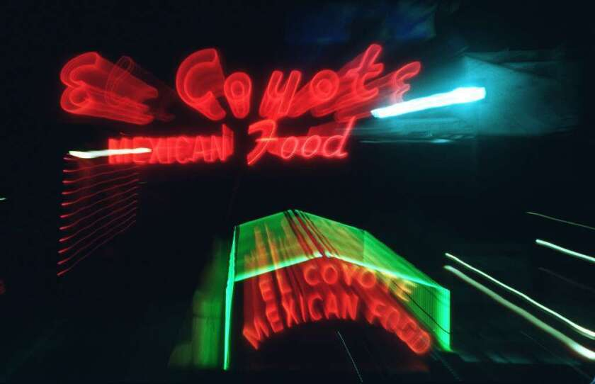 Red and green neon sign that reads El Coyote Mexican Food