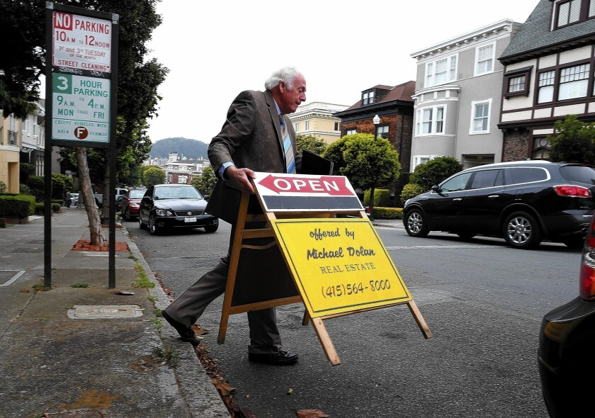 Home mortgage interest rates began the new year higher, according to Freddie Mac. Above, a San Francisco home for sale in July.
