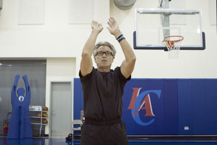 NBA Shooting Coach Bob Thate shows the mechanics of shooting the ball during a session with Los Angeles Times Reporter Chris Erskine.
