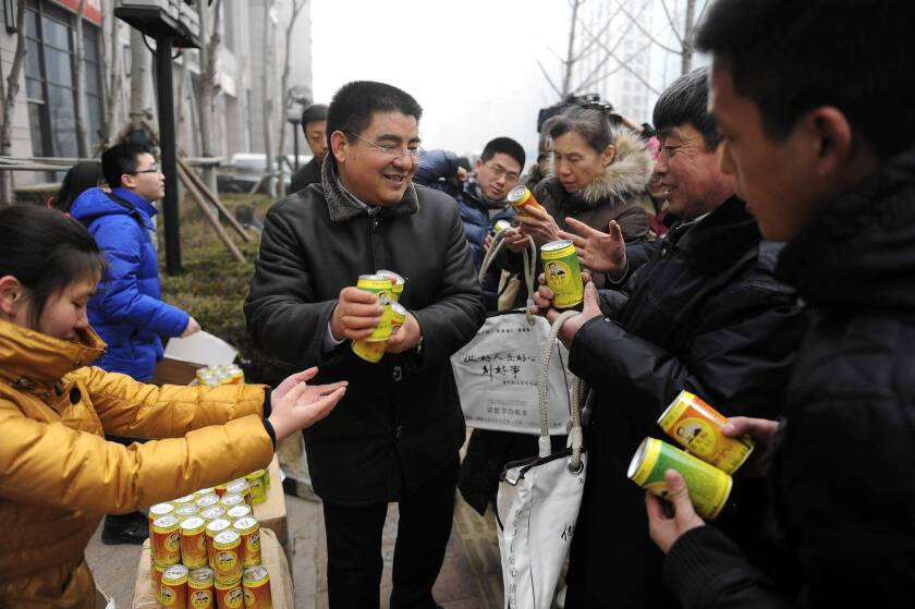 Chinese millionaire and philanthropist Chen Guangbiao hands out cans of air during a publicity stunt on a day of heavy air pollution last week at a financial district in Beijing.