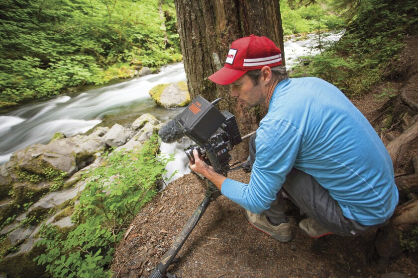 Ben Knight films an undammed river.