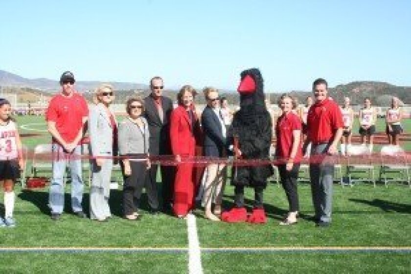 CCA Assistant Principal/Athletic Director Jeff Copeland, SDUHSD Vice President Amy Herman, SDUHSD Trustee Joyce Dalessandro, SDUHSDAssistant Superintendent Eric Dill, SDUHSD Clerk Beth Hergesheimer, SDUHSD President Barbara Groth, the Raven, CCA Foundation's Vice President of Athletic Programs Karen Dillen and CCA Principal Karl Mueller. Photos/Karen Billing