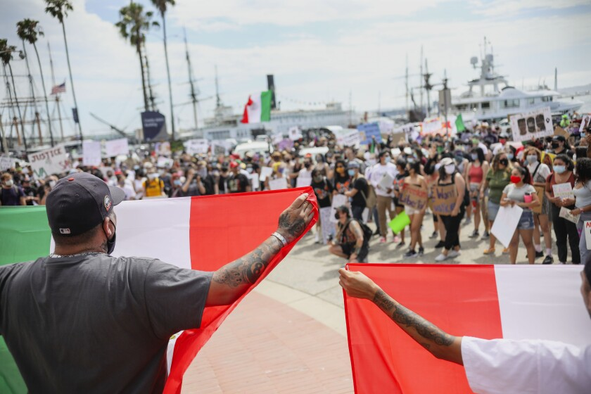 Abolish ICE and Black Lives Matter demonstrators gather at Waterfront Park on Saturday, July 11, 2020.