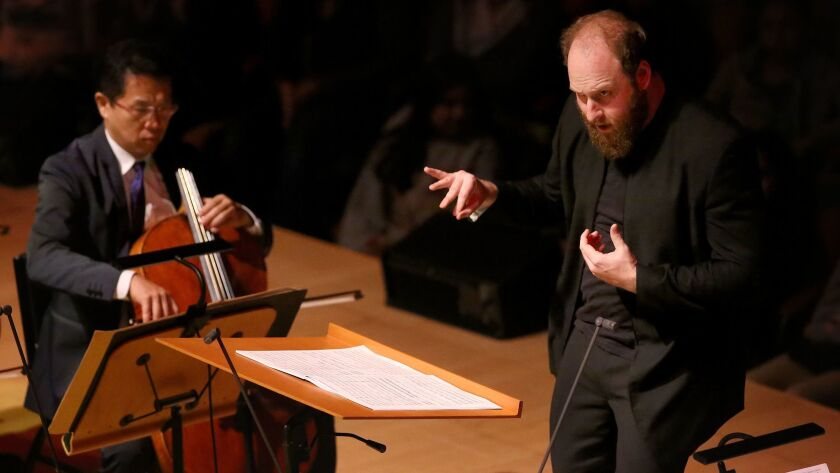 Christopher Rountree conducts the Los Angeles Philharmonic during a concert celebrating the work of high school composers' work at Walt Disney Concert Hall.