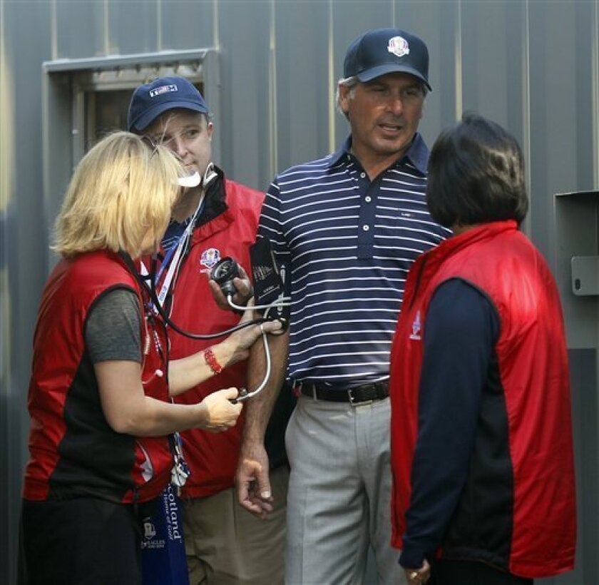 Fred Couples has his blood pressure taken near the 12th hole during a four-ball match at the Ryder Cup PGA golf tournament Saturday, Sept. 29, 2012, at the Medinah Country Club in Medinah, Ill. (AP Photo/Charles Rex Arbogast)