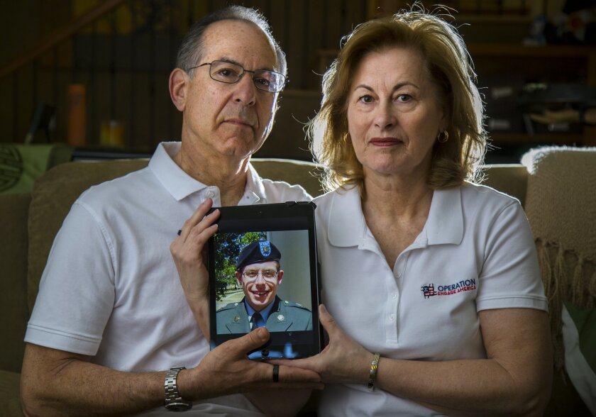 Howard and Jean Somers of Coronado with a portrait of their late son, Daniel Somers. / photo by Howard Lipin * U-T