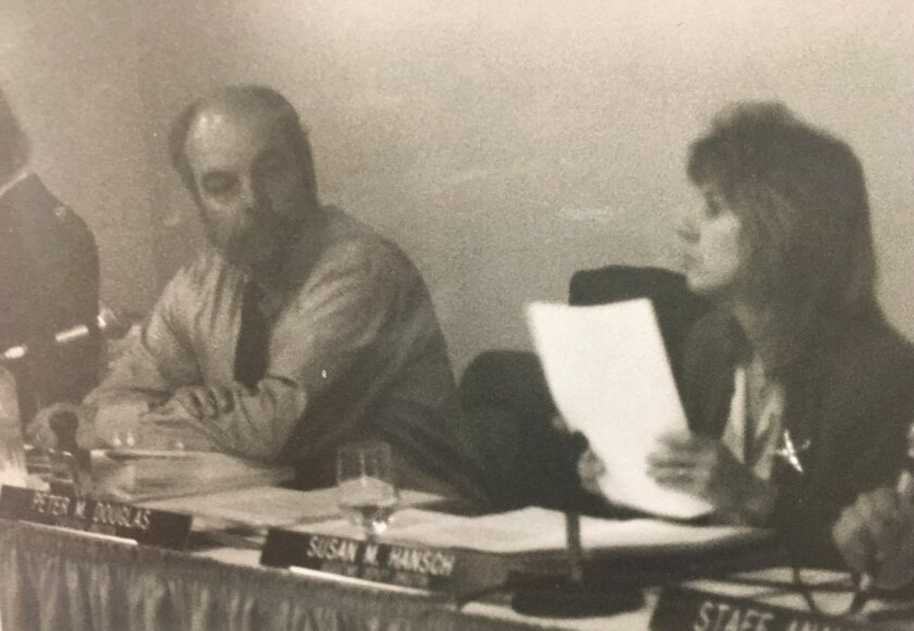 Peter Douglas, left, and Susan Hansch, right, at a California Coastal Commission meeting in the 1990s.