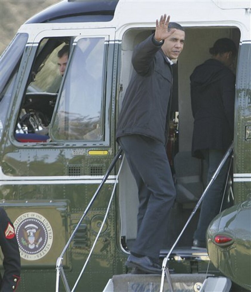 President Barack Obama boards Marine One on the South Lawn of the White House in Washington, Saturday, Feb. 7, 2009. The First Family was preparing to fly to Camp David for their first visit and overnight stay.(AP Photo/Lawrence Jackson)