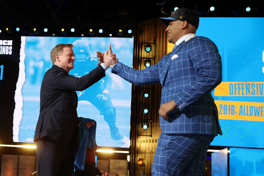 Northwestern tackle Rashawn Slater greets NFL Commissioner Roger Goodell after being selected 13th by the Chargers.
