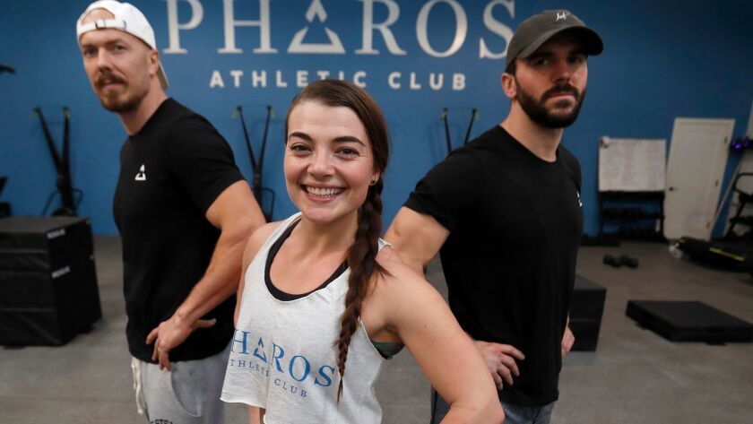 Pieter Vodden, left, with Emylee Covell and Jeff Scarborough are coaches and co-owners of the Pharos Athletic Club in Echo Park.