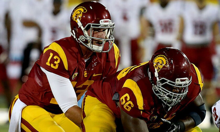 USC quarterback Max Wittek takes a snap from center Marcus Martin during a Sept. 7 loss to Washington State. Wittek plans to play at another university next season.