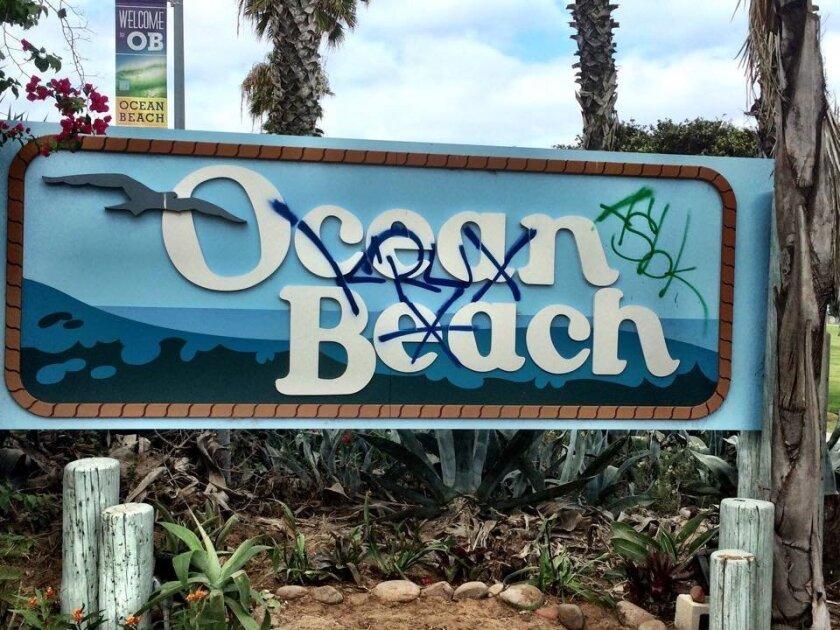 The Ocean Beach entry sign was damaged with graffiti. / Photo courtesy Gretchen Newsom