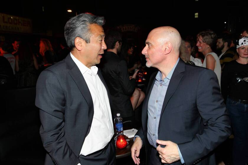 """Warner Bros. Chief Executive Kevin Tsujihara, right, reportedly gets along well with Warner Pictures Group President Jeff Robinov. They are shown chatting at the premiere of """"Rock of Ages"""" at Grauman's Chinese Theatre in June."""