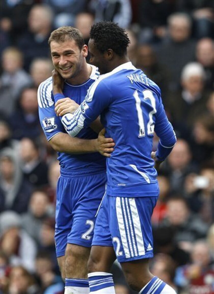 Chelsea's Branislav Ivanovic, left, celebrates his goal with John Obi Mikel during the English Premier League soccer match between Chelsea and Aston Villa at Villa Park Stadium in Birmingham, Saturday, March 31, 2012. (AP Photo/Kirsty Wigglesworth)