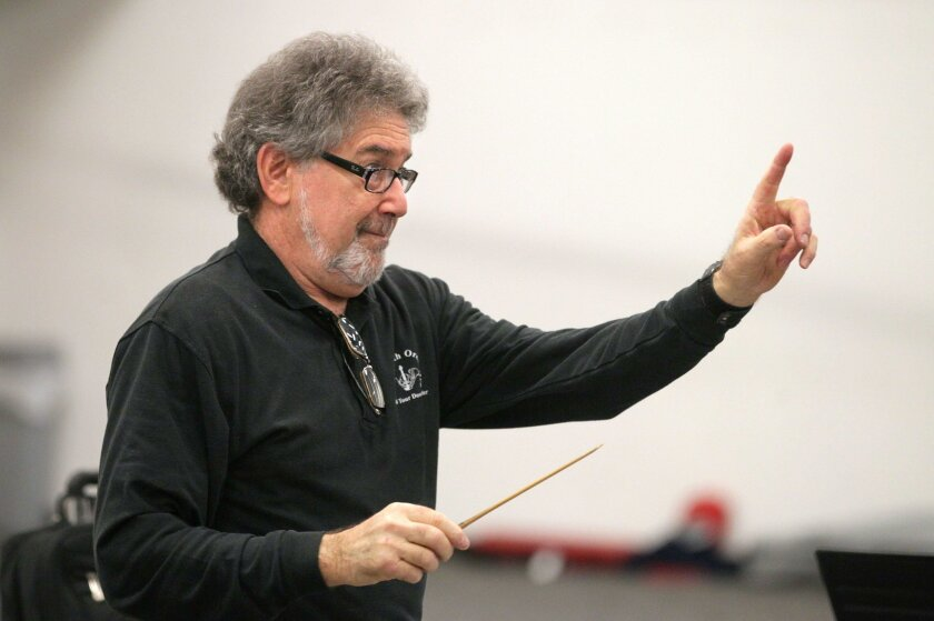 Conductor Bob Gilson, of the San Diego Civic Youth Orchestra, leads rehearsal at Classical Academy High School in Escondido.