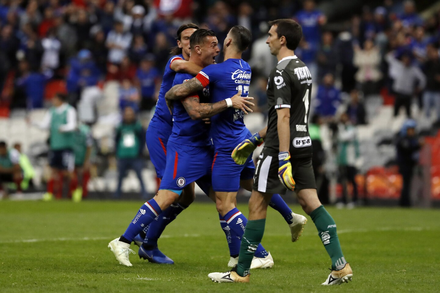 Cruz Azul players celebrate a goal scored by Milton Caraglio, second from left, against Monterrey during a Mexico soccer league second leg semifinals match against Monterrey at Azteca stadium in Mexico City, Saturday, Dec. 8, 2018. (AP Photo/Moises Castillo)