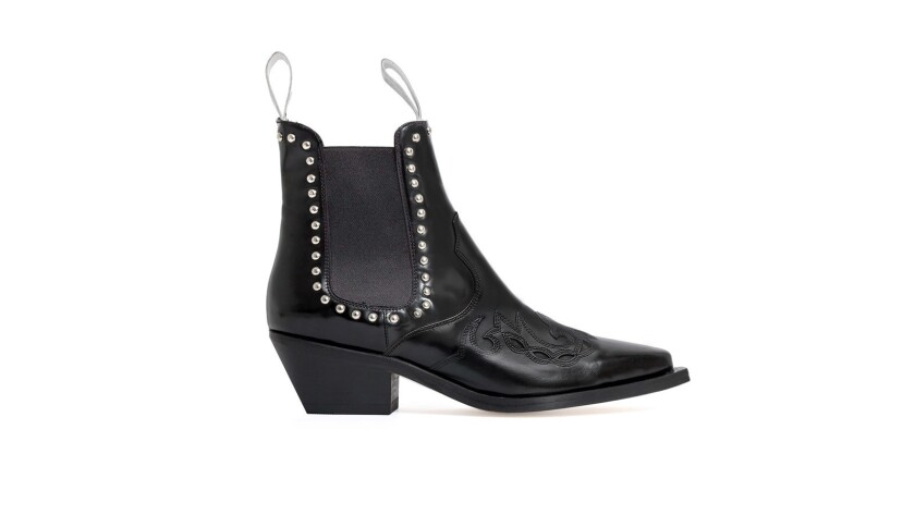 The Texas is a glossed leather boot with silver dome studs. Approximately $495. havvamustafa.com.