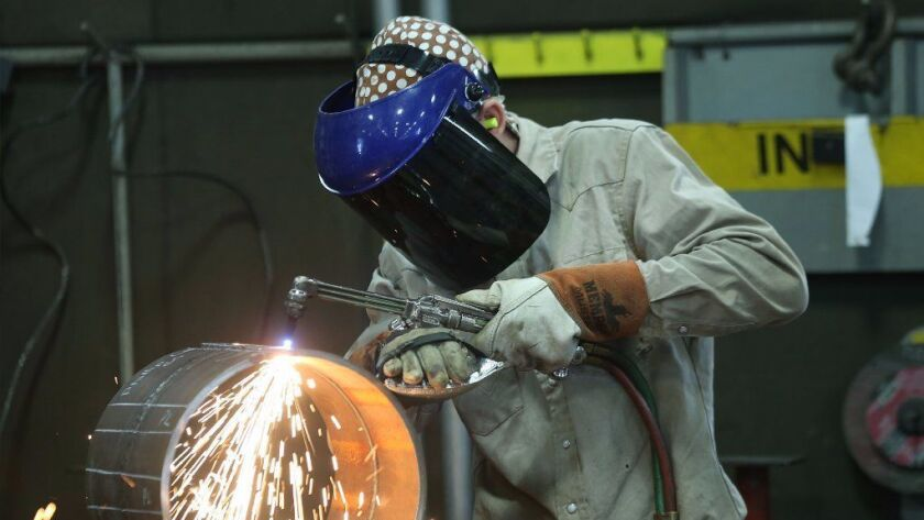 An employee welds pipe at Pioneer Pipe on October 25, 2016 in Marietta, Ohio. The construction, maintenance and fabrication company employs around 800 people, supplying products to the oil and gas industry.
