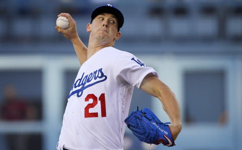 Dodgers starting pitcher Walker Buehler throws against the Arizona Diamondbacks on July 3.