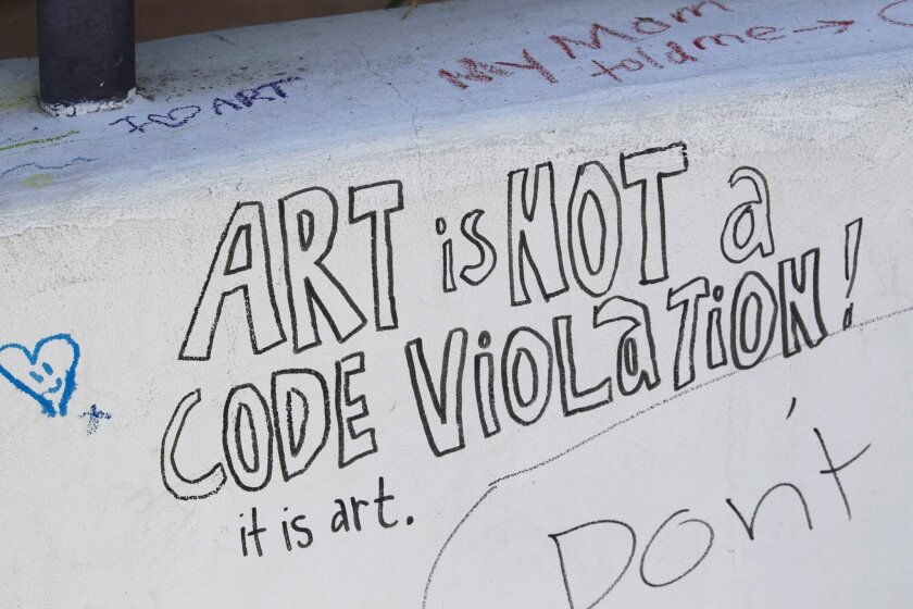 """La Jolla artist Nasser Pirasteh, whose artwork has been ordered removed by the City, was given a two week extension of the deadline after a death in his family.  He is hoping that with the public's help he can keep the sculpture he has named """"In Out"""" in his front yard. The front wall in front of hi"""