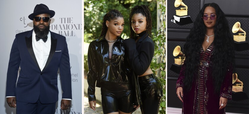 """In this combination photo, Black Thought attends the 3rd Annual Diamond Ball on Sept. 14, 2017, in New York, from left, Halle Bailey and her sister Chloe Bailey, of Chloe X Halle, pose for a portrait in their backyard in Los Angeles on May 28, 2020, and H.E.R. arrives at the 63rd annual Grammy Awards on March 14, 2021, in Los Angeles. The artists and others have recorded songs honoring Juneteenth for Apple Music. Some artists recorded cover songs, while others composed new tracks for the exclusive """"Juneteenth 2021 Freedom Songs"""" playlist, which launches Friday, June 4, 2021, on the streaming platform. (AP Photo)"""