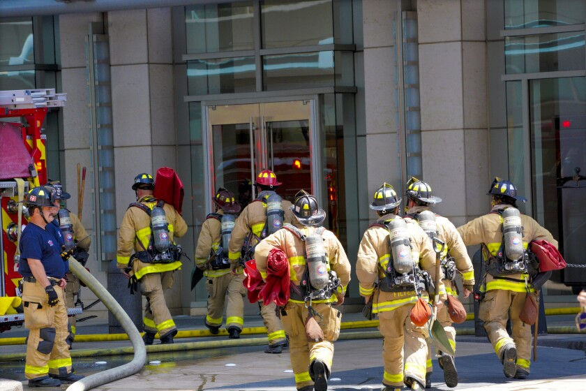 Dozens of fire engine crews respond to a three alarm high rise fire at the Omni Hotel in downtown.