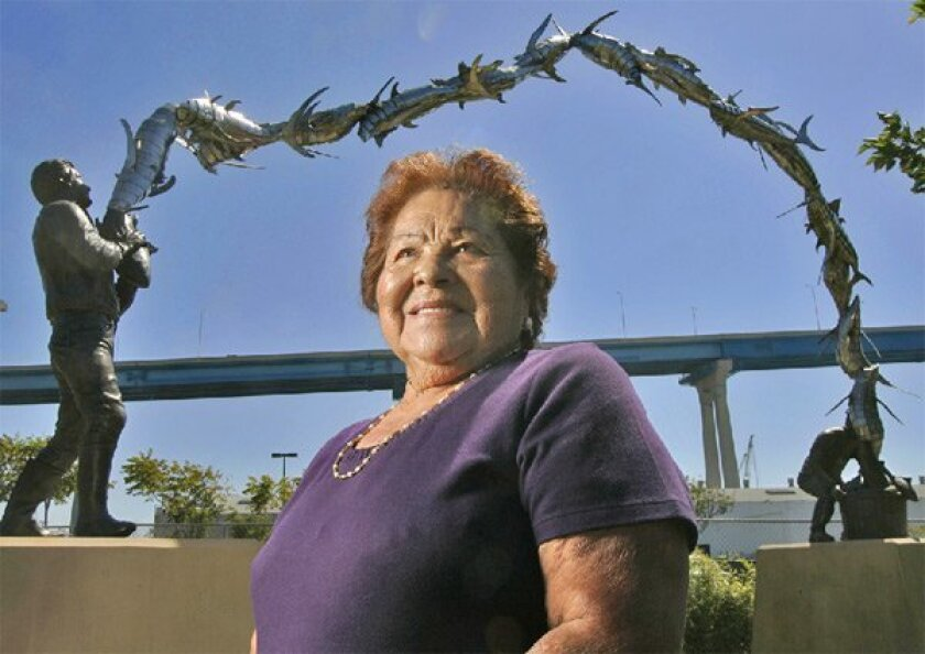 Former cannery worker Eloisa Osuna, 87, will attend today's tribute to the industry in Barrio Logan. A sculpture depicting a tuna fisherman and two cannery workers will be unveiled. (Eduardo Contreras / Union-Tribune)