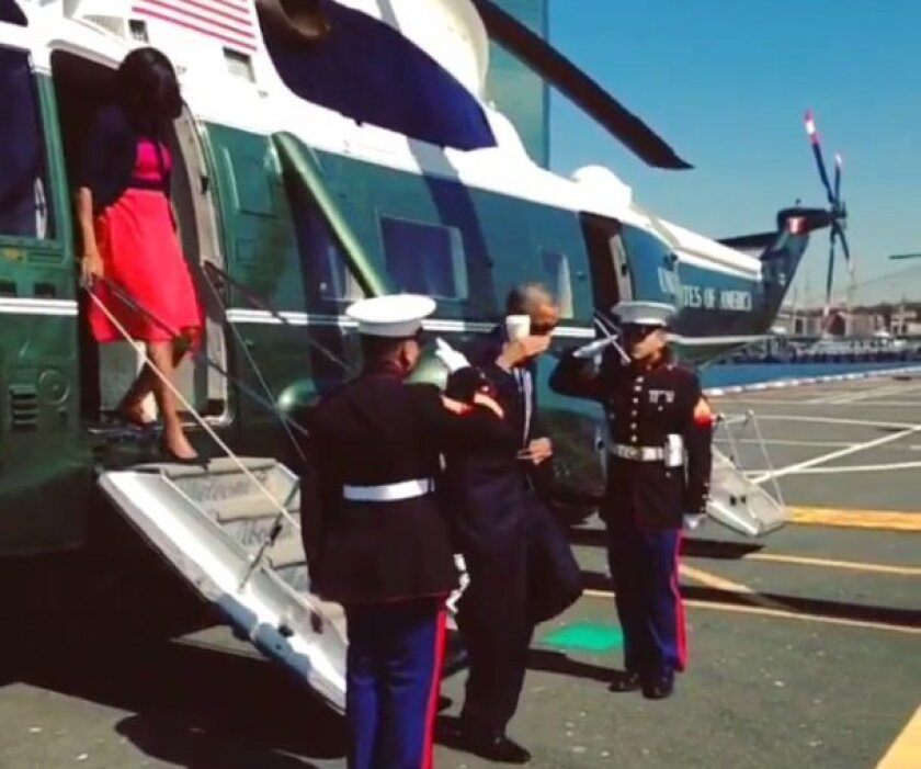 President Barack Obama offers a salute in New York Tuesday.