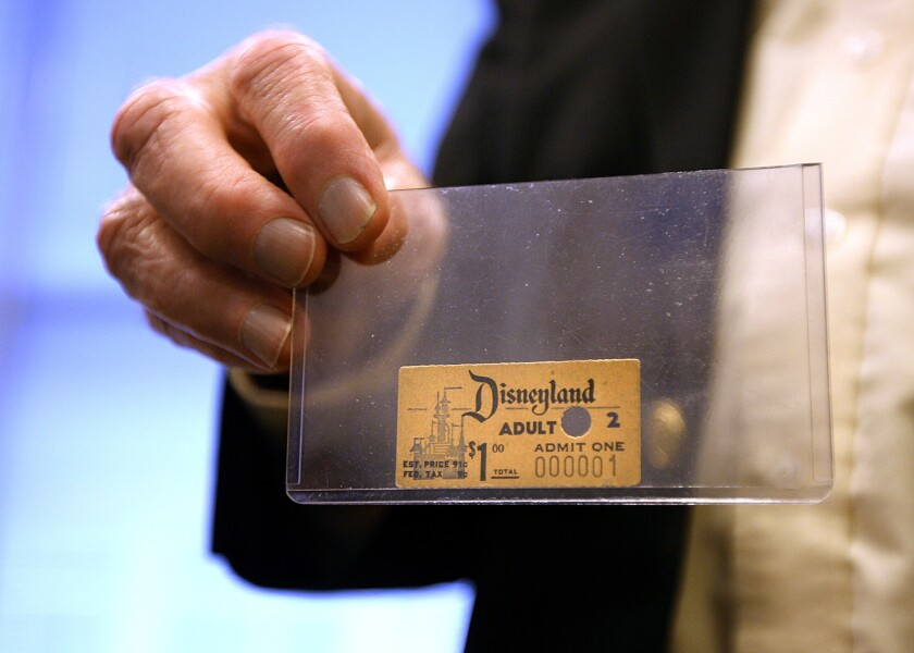The first Disneyland admission ticket ever sold is held by archivist Dave Smith at Walt Disney Studios in Burbank in April 2010.
