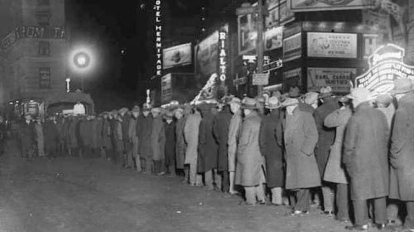 A bread line in New York's Times Square in December 1930. The U.S. government made many early missteps in its response to the Great Depression.