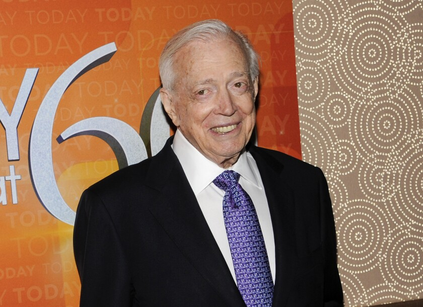 """FILE - This Jan. 12, 2012 file photo shows Hugh Downs at the """"Today"""" show 60th anniversary celebration in New York. Downs, a genial and near-constant presence on television from the 1950s through the 1990s, has died. His family said Downs died of natural causes Wednesday, July 1, 2020, in Scottsdale, Ariz. He was 99. Downs was a host of the 'Today' show on NBC, worked on the 'Tonight' show when Jack Paar was in charge, and hosted the long-running game show """"Concentration."""" (AP Photo/Evan Agostini, File)"""